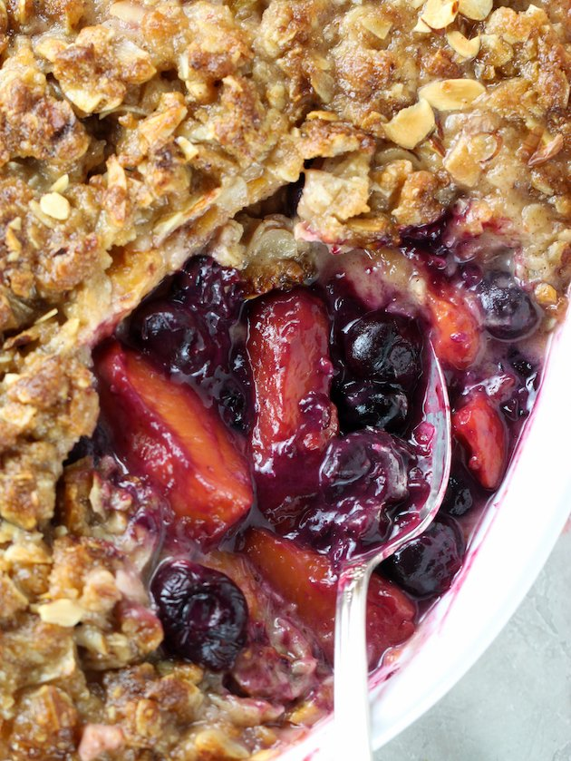 Close up partial Peach Blueberry Crisp in baking dish