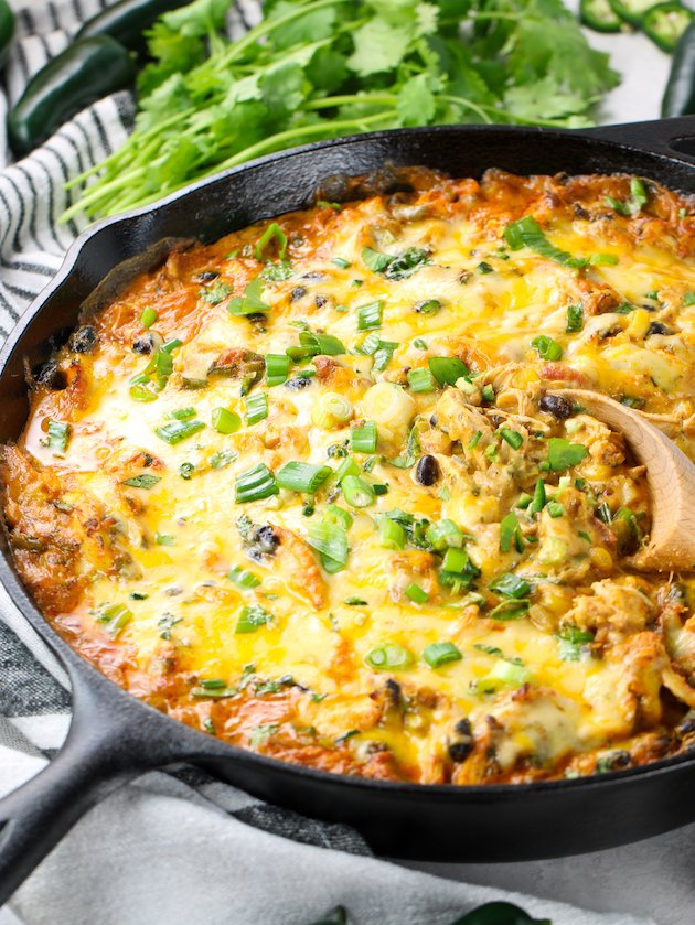 Eye level partial skillet of Chicken Enchilada appetizer