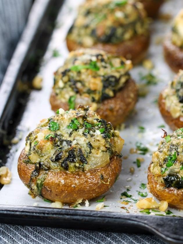 Close up stuffed mushroom with onion, spinach, feta, and walnuts