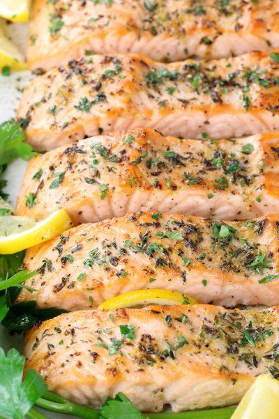 partial platter of baked lemon pepper salmon filets
