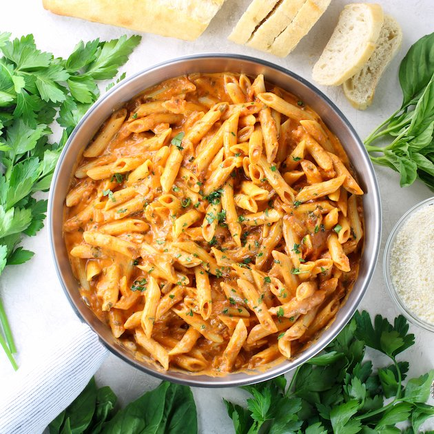 silver saute pan with chicken penne pasta in vodka sauce