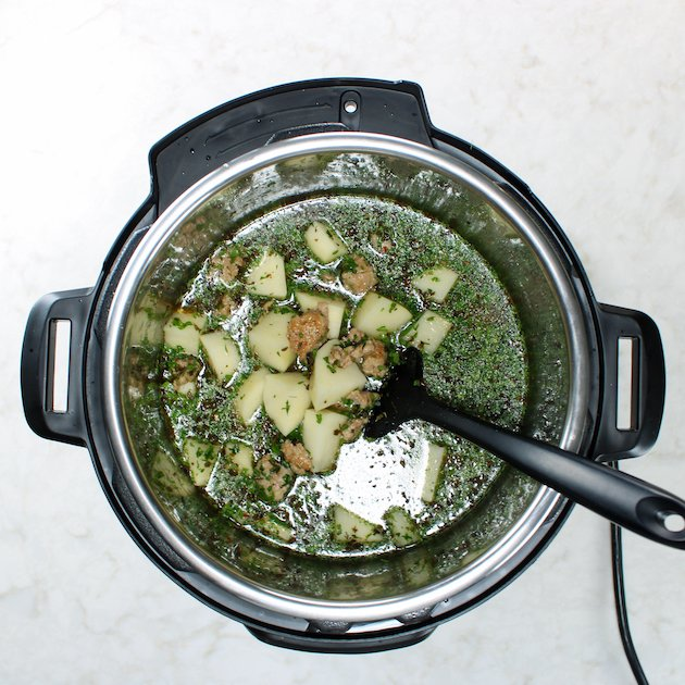 Instant pot with soup ingredients before cooking