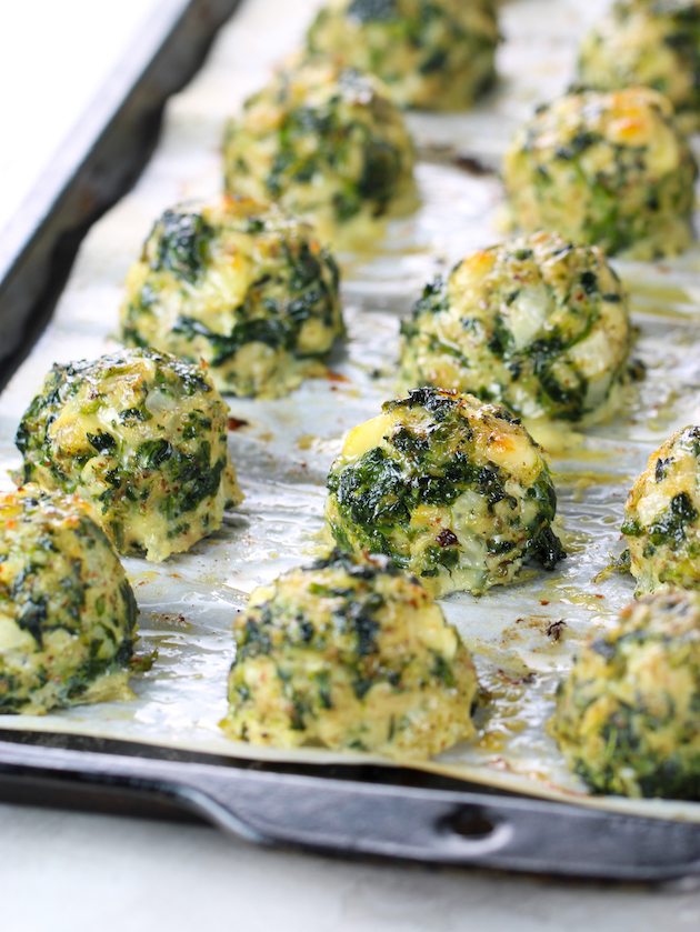 partial baking sheet of feta spinach chicken meatballs