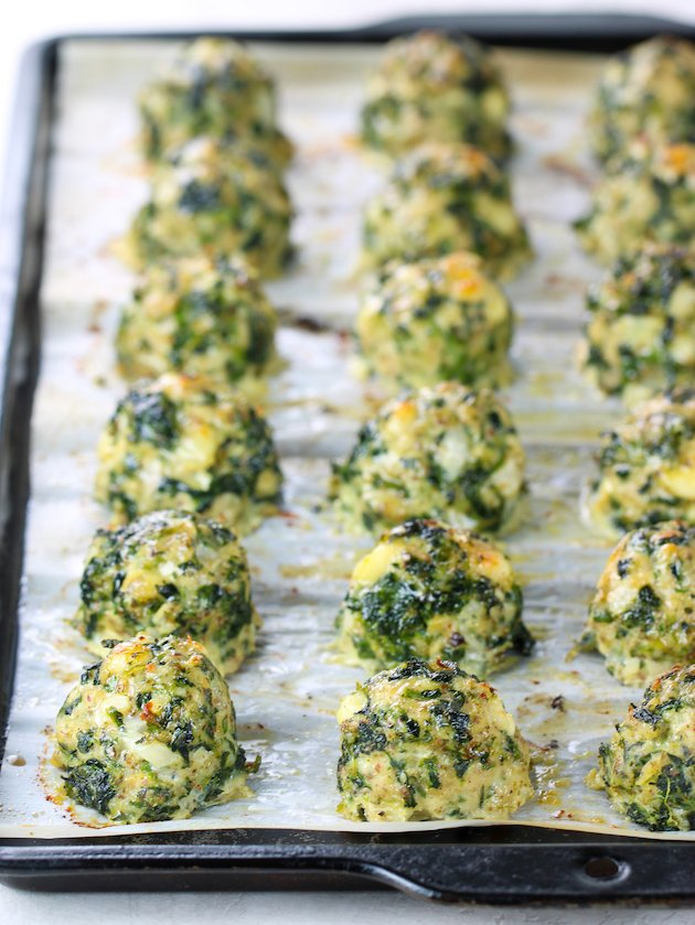 baking sheet of chicken meatballs with feta and spinach