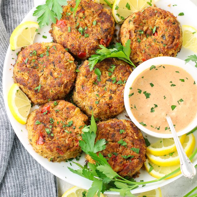 Platter of crab cakes with dipping sauce