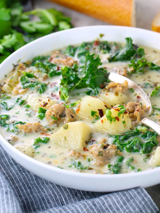 eye level partial bowl of italian soup with kale and sausage
