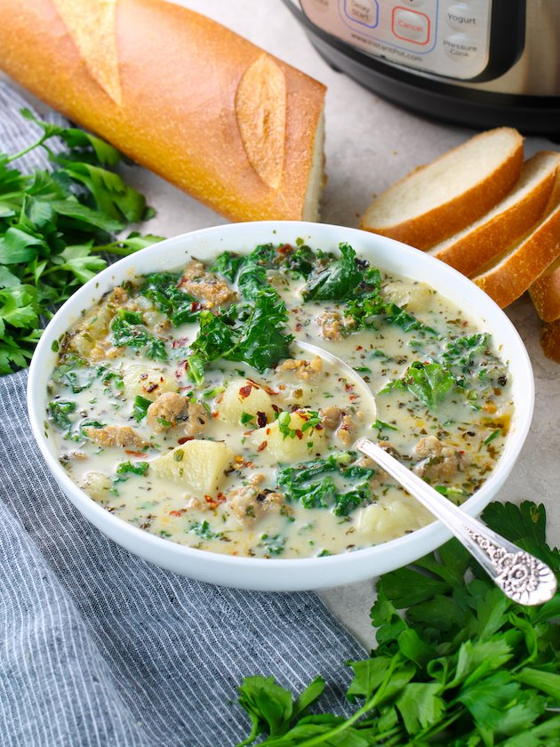 white bowl of italian soup on table with instant pot