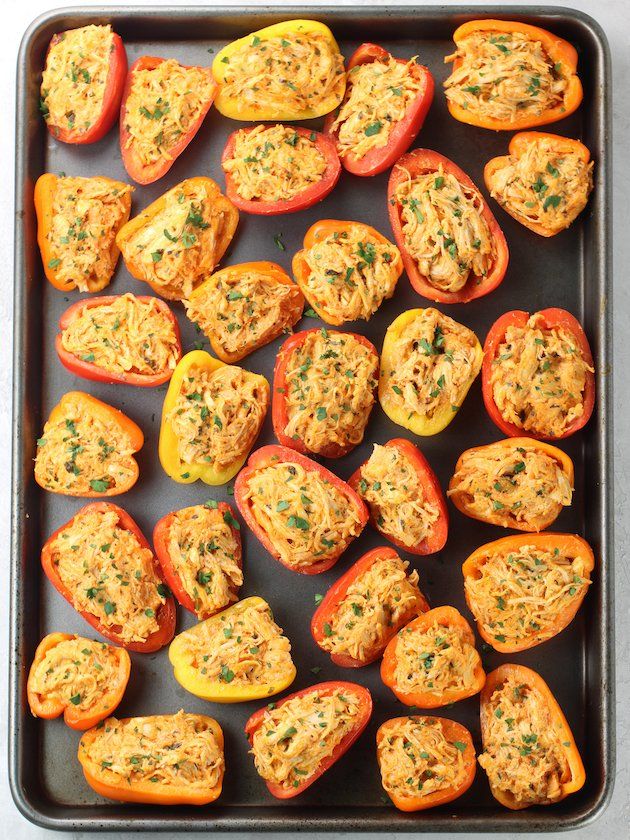 Stuffed Baby Bell Peppers on a baking sheet before cooking
