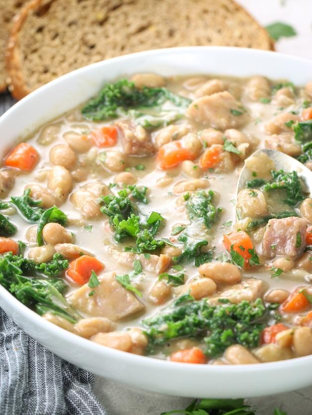 close up eye level of white bean ham hock soup