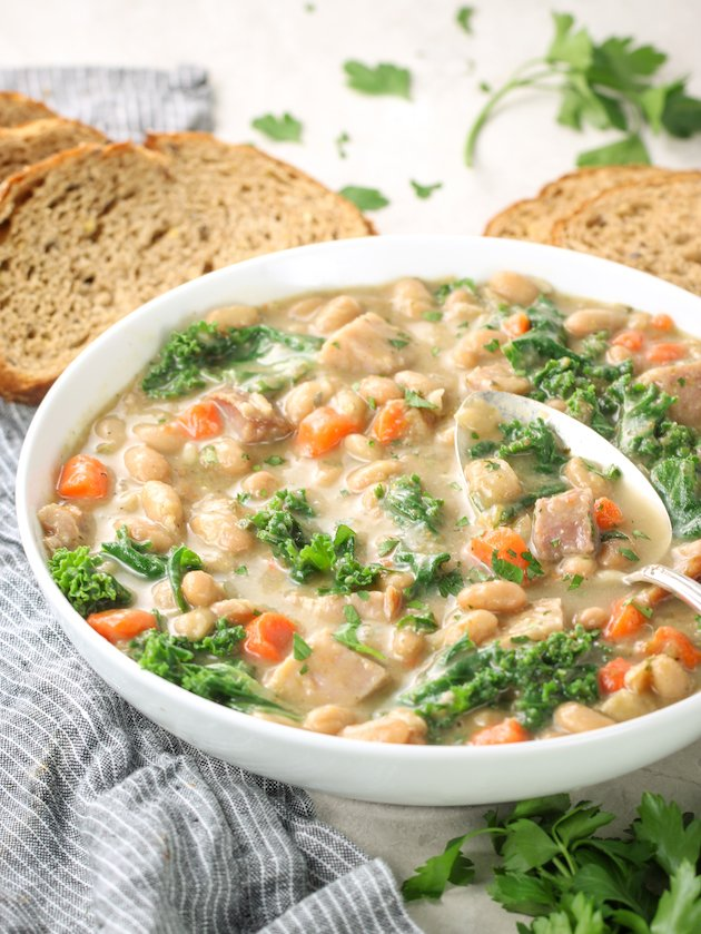 eye level bowl of white bean soup with ham
