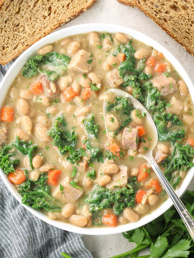 bowl of white bean soup with kale