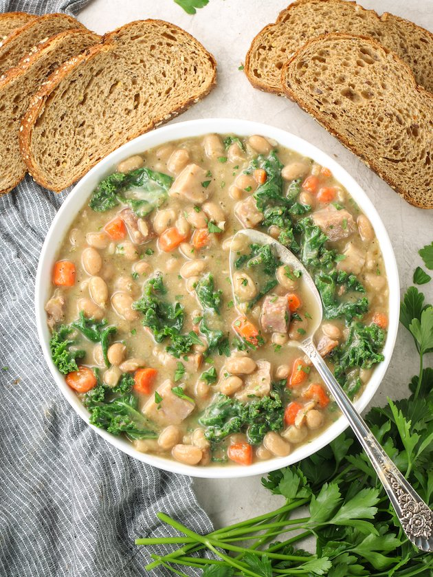 white bean and ham soup with kale in a bowl