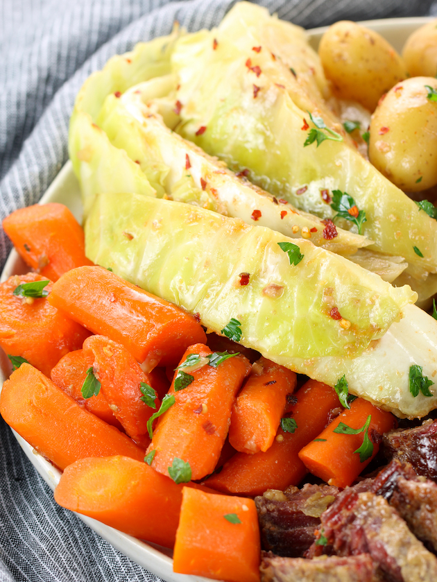 Partial platter of slow cooker cabbage and carrots for St. Patrick's day