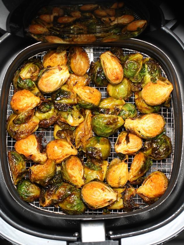 vegetables cooking in an air fryer