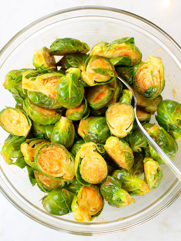 Bowl of brussel sprouts tossed in buffalo hot sauce