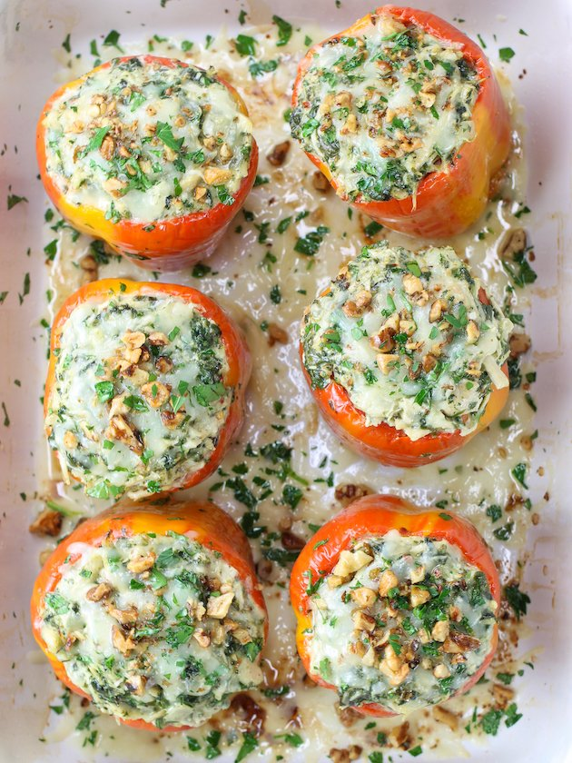 6 Chicken Florentine Stuffed Peppers with melted cheese in casserole dish