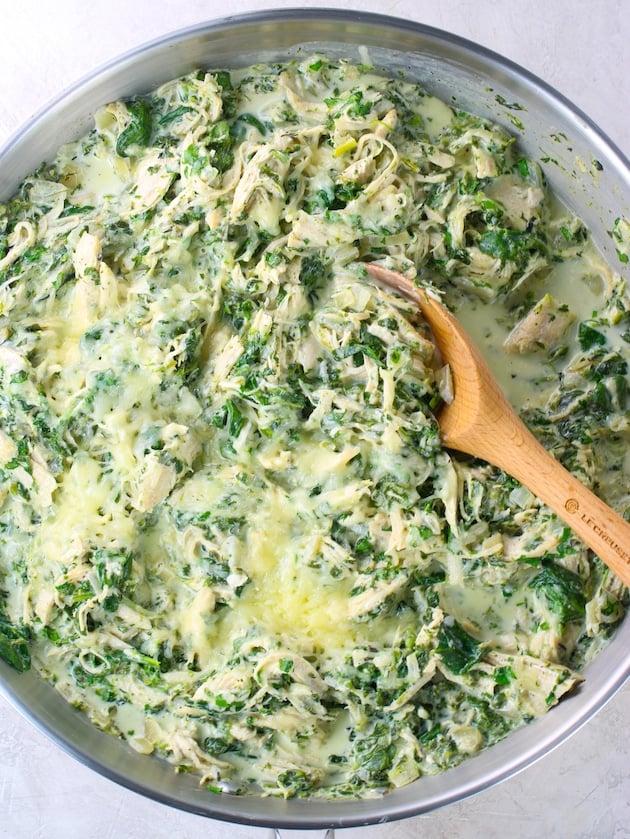 Chicken spinach Florentine stuffing in saute pan