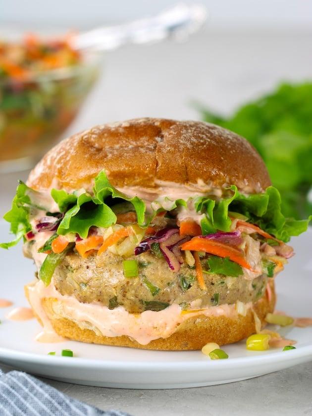 Eye level close up Tuna burger with asian slaw on a wheat bun