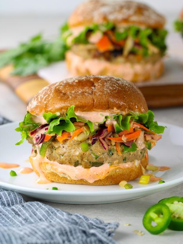close up fish burger with asian slaw