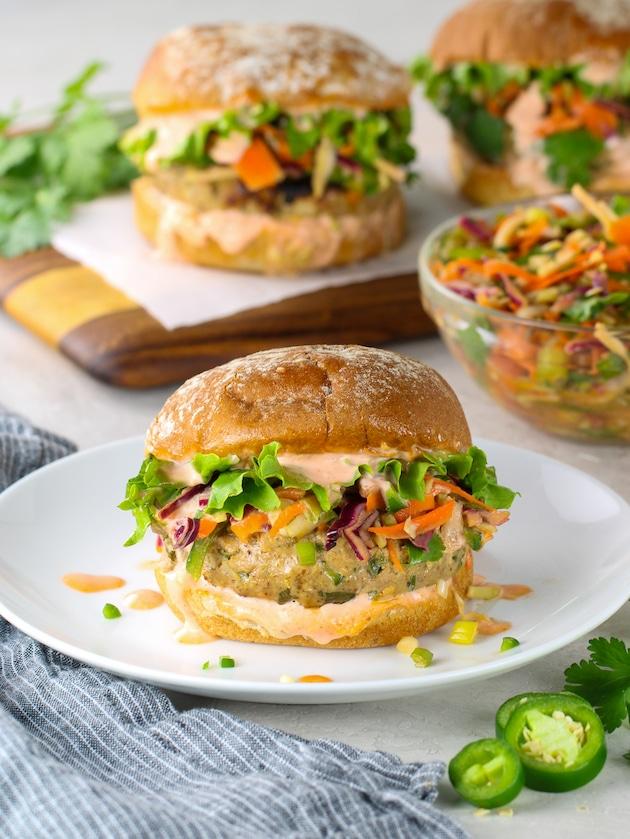 Ahi tuna burger with asian slaw on a plate