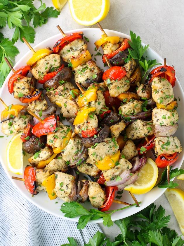 Platter of chicken kabobs with veggies