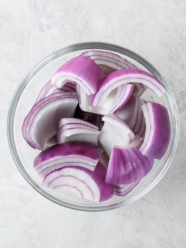glass bowl of red onions