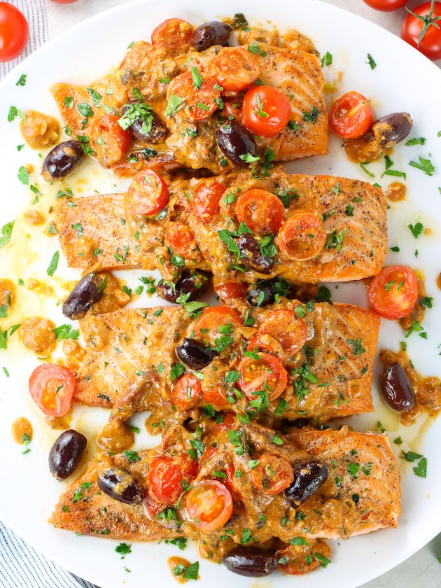 Salmon filets with tomato sauce on a platter
