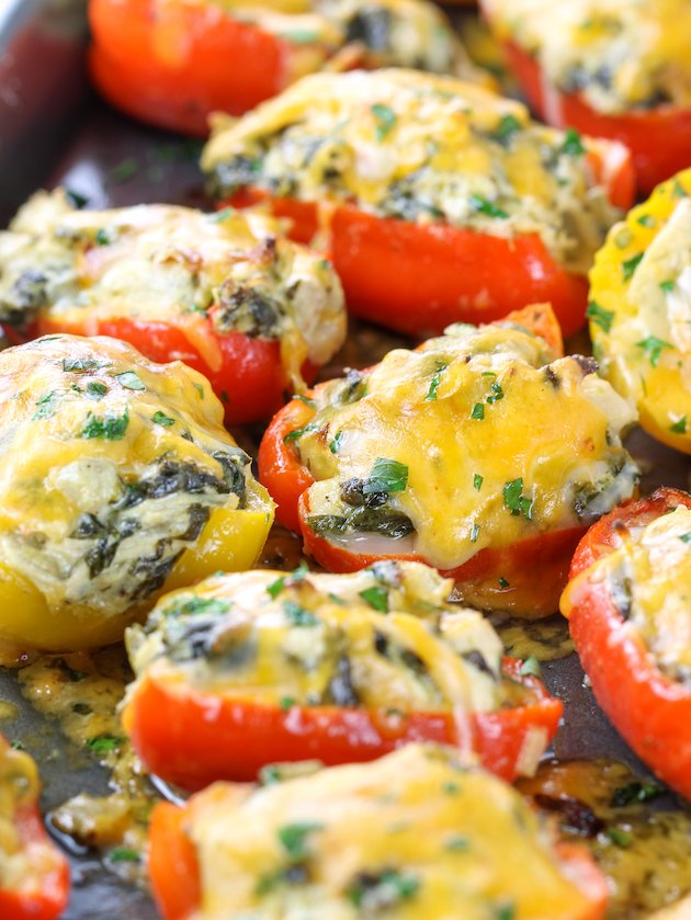 close up mini stuffed peppers with chicken spinach and artichoke