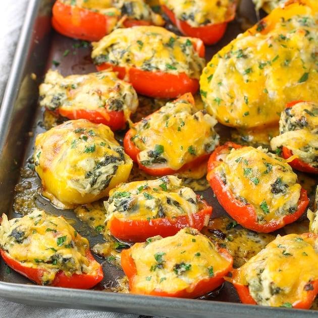 baking sheet of Spinach Artichoke Chicken Stuffed Peppers