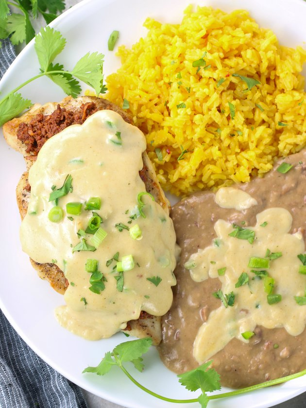 Grilled mexican chicken with rice and refried beans