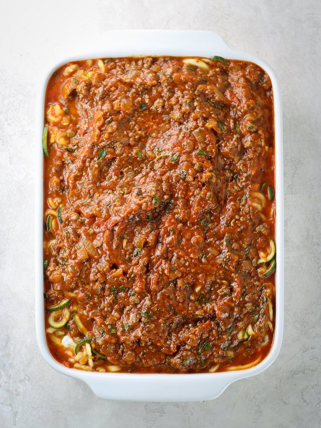 Casserole dish topped with red sauce