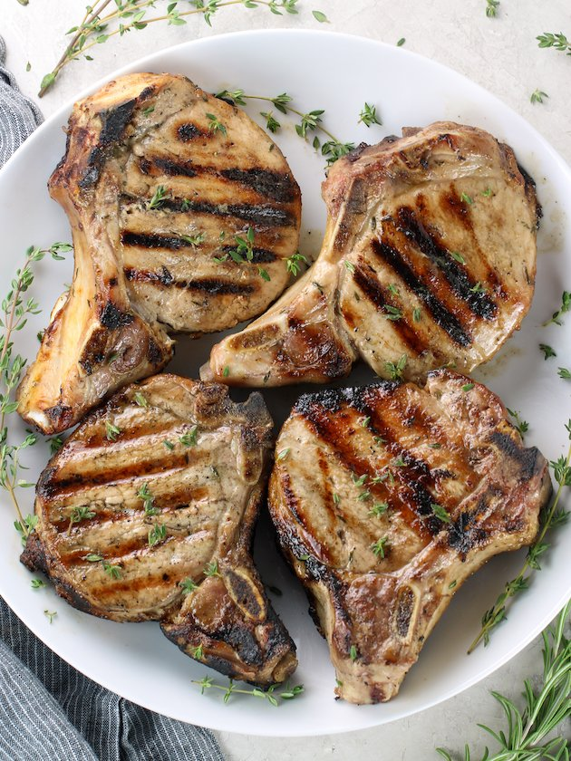 Four Perfect Grilled Pork Chops on a platter
