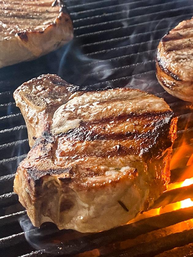 Close up pork chops grilling