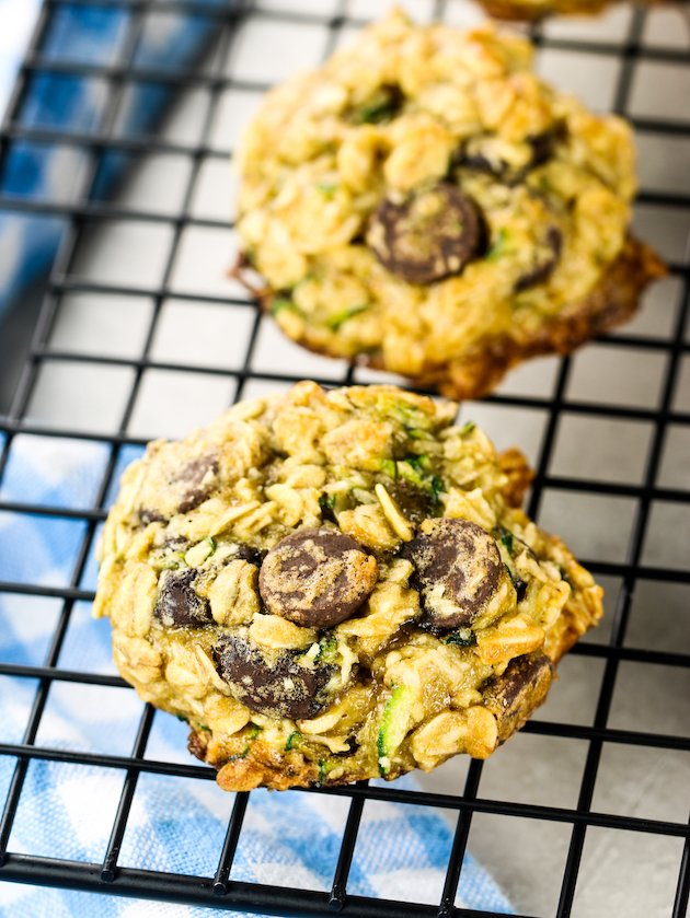 very close up zucchini oatmeal chocolate chip cookie cooling on wire rack